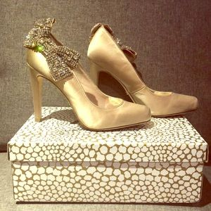 ABS pumps with rhinestone bow.
